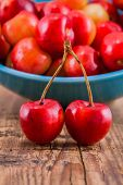 Organic Rainier Cherries On Wooden Background