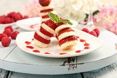 Fresh strawberry with banana on skewers on plate on table close-up