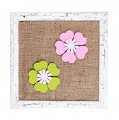 Wooden frame with decorative flowers isolated on white