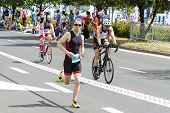 Runner And Cyclists During First Triathlon Szczecin Race.