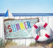 White Fence and Summer Signboard on Beach