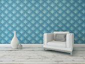 Rustic interior living room decor with a comfortable cream armchair against a wall with a large patterned blue wallpaper on a grunge white painted wooden floor with vase ornaments