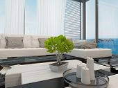 Modern bright airy living room or lounge interior overlooking the sea with large view windows with c