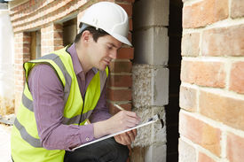 picture of check  - Architect Checking Insulation During House Construction project - JPG