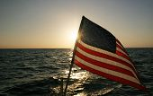 American flag and sunset