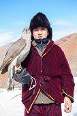 Nura, Kazakhstan - February 23: Eagle On Kid's Hand In Nura Near Almaty On February 23, 2013 In Nura