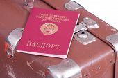 Passport On An Old Suitcase