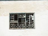stock photo of derelict  - Broken windows in old abandoned derelict house on wall - JPG