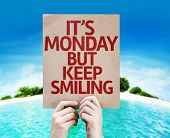 It's Monday But Keep Smiling card with a beach on background