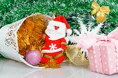 Santa Claus With White Bucket, Pink Gift Box And White Snowflake