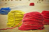 stock photo of nylons  - Colourful Nylon Fishing Ropes on the Beach - JPG