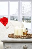 Christmas candles with winter snow scene window