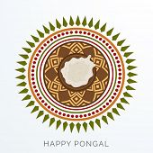 Traditional mud pot with rice on floral design decorated rangoli for South Indian harvesting festival, Happy Pongal celebrations.
