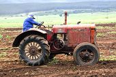 Vintage Red Tractor Being Demonstrated On Farm