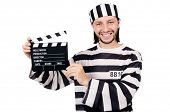 Funny prison inmate with movie board isolated on white