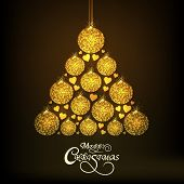 Beautiful X-mas Tree design made by golden X-mas Balls and hearts on brown background for Merry Christmas celebrations.