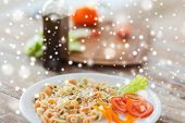 cooking, food and home concept - close up of pasta meal on plate