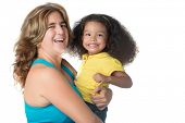 Adult woman carrying a cute african american girl and laughing isolated on white