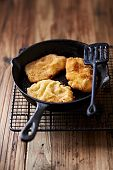 picture of wieners  - Wiener Schnitzel on a cast iron pan  - JPG