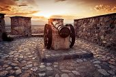 foto of cannon  - old cannon at fortress in sunset light - JPG