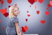 Little girl with hearts indoors