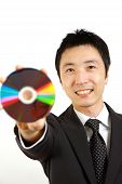 businessman showing a media disc