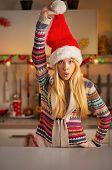 Happy Teenager Girl In Santa Hat Having Fun Time In Christmas De