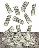 big pile of money. dollars over white wood background