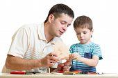 Dad and son kid make nesting box