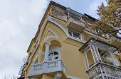 Fragment of old renovated building with balcony and ornaments, Sofia
