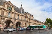 Facade Of The Louvre Museum With Entrance Gates, Paris
