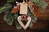 Wooden Heart And Paper Tag Hanging On Christmas Tree