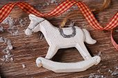 Christmas Decoration With Rocking Horse On Wooden Background
