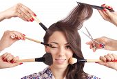 picture of scissors  - Girl and a lot of hands with comb scissors and brushes for makeup - JPG