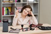 Happy Girl In The Office With Cosmetics