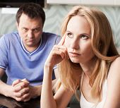 Conflict between man and woman at home. Couple divorce
