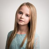 Blue Eyed Young Girl In Turquoise Top Isolated