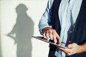 Male entrepreneur using digital tablet