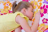 Little girl sleeping on pillow