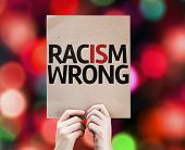 Racism Wrong card with colorful background with defocused lights
