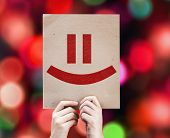 Smiley Face card with colorful background with defocused lights