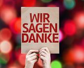We Say Thank You (In German) card with colorful background with defocused lights