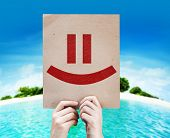 Smiley Face card with a beach on background