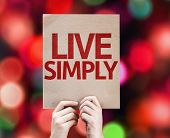 Live Simply card with colorful background with defocused lights