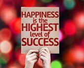 Happiness is the Highest Level Of Success card with colorful background with defocused lights