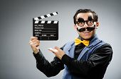 stock photo of clapper board  - Funny man holding movie clapper - JPG