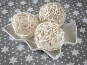 Three christmas string ball ornaments on white plate