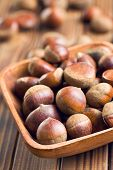 chestnuts in bowl on wooden table