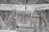 Wooden Door On Farm Wall In France