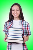 Student girl with many books on white
